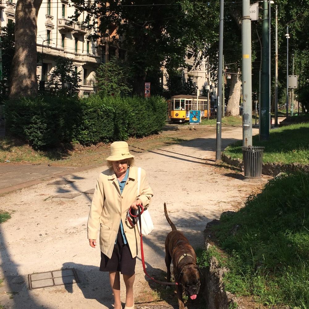 a woman walking in Milano luxury tour